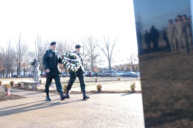 Col. Bill Hickman (left) and Command Sgt. Maj. Scott Schroeder lay a wreath at the Fort Campbell Gander Memorial Park Dec. 12, 2008 in honor of Strike Brigade members who were killed in a 1985 plane crash. Dec. 12 marks the 23rd annivesary of the worst single day loss of American Soldiers since World War II.