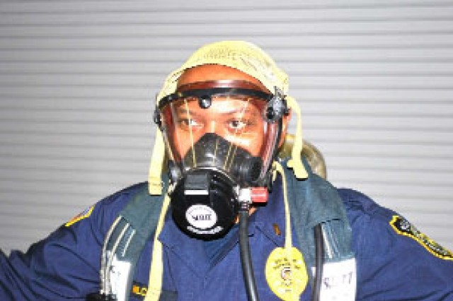 DES police officer Fredric Wilcox gets familiar with a self contained breathing apparatus.