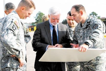 Under secretary of the army helps cut ribbon marne point for Randy stewart builder
