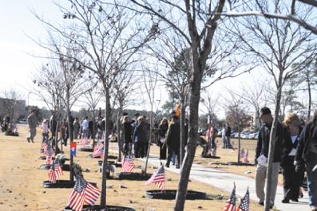 More than 3,000 Families, Soldiers, veterans and members of the Stewart-Hunter community came to Warrior's Walk to pay honor to the 417 fallen 3rd ID Soldiers by placing a wreath at the base of each Eastern Redbud tree, Dec. 13.