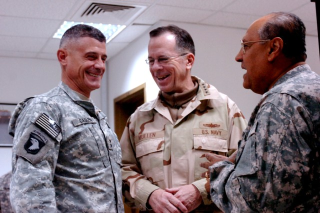 Maj. Gen. Robert L. Caslen Jr., commander, Multi-National Division - North, enjoys a friendly chat with Navy Admiral Mike G. Mullen, Chairman of the Joint Chiefs of Staff, and Victor Daoud, an Army Linguist with Task Force Lightning, at Contingency Operating Base Speicher, near TIkrit, Iraq, Dec. 18. Mullen was among many U.S. military leaders in Iraq to welcome Task Force Lightning to the northern-Iraq region. (Photo by Pvt. 1st Class Jesus J. Aranda, Task Force Lightning Public Affairs)
