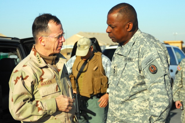 Navy Admiral Mike G. Mullen, Chairman of the Joint Chiefs of Staff, arrives with Lt. Gen. Lloyd J. Austin III, commander, Multi-National Corps - Iraq at Contingency Operating Base Speicher near Tikrit, Iraq, Dec. 18.  Mullen and Austin paid a visit Task Force Lightning headquarters and 25th Infantry Division leadership, who assumed responsibility for northern-Iraq earlier this month. (Photo by Spc. Ryan Elliot, 14th Mobile Public Affairs Detachment)