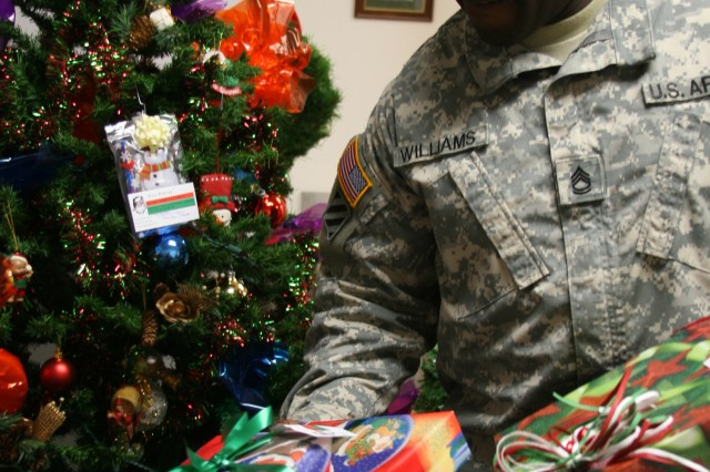 WHEELER ARMY AIRFIELD, Hawaii - Sgt. 1st Class Vernon Williams, 599th Transportation Group first sergeant, checks presents members of the 599th have brought for the Smock quadruplets at 599th headquarters, Dec. 15.