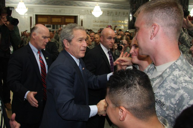 President George W. Bush pauses to thank Soldiers individually at Bagram Air Base Afghanistan Dec. 15.
