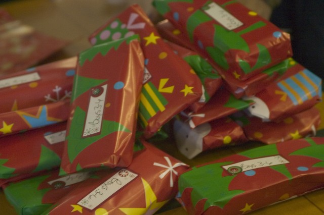 SCHOFIELD BARRACKS, Hawaii - Freshly wrapped presents stacked high as Wolfhounds and family members prepare to bring the spirit of Christmas to the more than 130 children currently living at the Holy Family Home in Osaka, Japan.