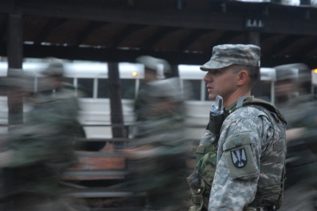 Sgt. 1st. Class Gabriel Lopez, a drill sergeant with Company F, 2nd Battalion, 39th Infantry Regiment, waits for his Soldiers to board the buses, which take them to Omaha Beach Range.