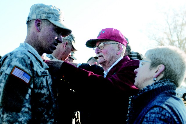 Retired Col. Jack Ancker pins Airborne wings on his grandson, 1st Lt. Philip Sakala while Sakala's mother, retired Col. Mary Ancker watches. All are now Airborne qualified.