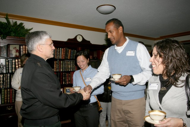 Gen. George Casey, Chief of Staff of the Army, shakes hands with SGT Jose Sepulveda during a breakfast visit with deployed spouses at MG Wiercinski's house, Dec. 19, 2008.