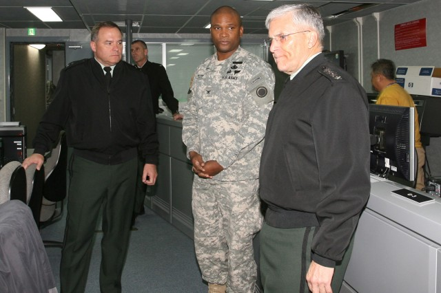 Gen. George Casey, Chief of Staff of the Army, visits the U.S. Army, Japan & I CORPS (FWD) new Command center.  At center is Colonel Alan Neyland, USARJ G3 and I CORPS (FWD) Chief of Staff.