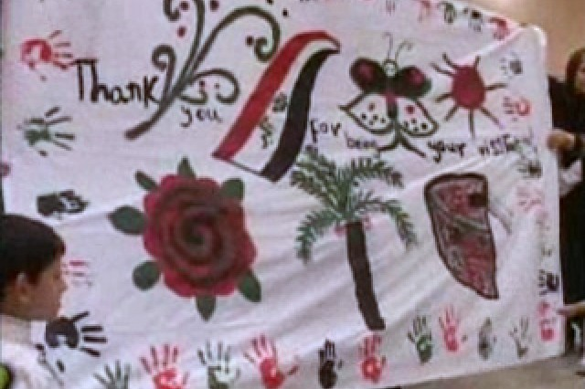 Iraqi students present their American counterparts with a work of art.