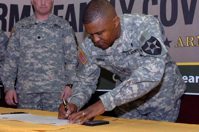 Maj. Gen. John W. Morgan III, commanding general for the 2nd Infantry Division signs the Army Family Covenant document during the ceremony held at the Pear Blossom Cottage 23 Dec. at Camp Casey.