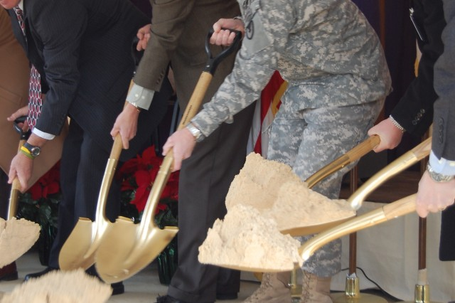 Jyuji Hewitt, deputy to the commander, JMC, (l) and Lt. Col. (P) Jon Drushal, Radford Army Ammunition Plant commander, shovel dirt during a ground-breaking ceremony Dec. 4, for the plant's new nitric acid concentrator/sulfuric acid concentrator.