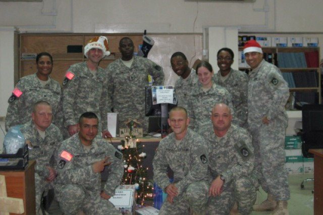 Soldiers from the 10th Sustainment Brigade's personnel shop on Camp Taji, Iraq, take time out to pose for a holiday photo to send to loved ones back home. The Soldiers of the brigade recently deployed to Iraq as part of the unit's first Operation Iraqi Freedom deployment. Previously the 10th Sustainment Brigade has twice deployed in support of Operation Enduring Freedom.