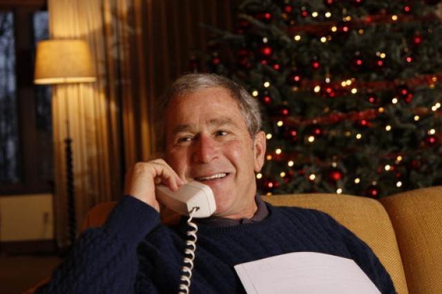 President George W. Bush makes a Christmas Eve telephone call to members of the Armed Forces Dec. 24, 2008, from Camp David.