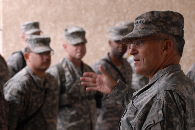 Army Chief of Staff Gen. George Casey Jr. prepares to present a campaign streamer during a ceremony Dec. 22 in Baghdad.