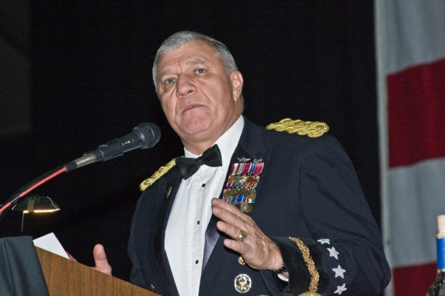 Retired Gen. Dick Cody, former vice chief of staff and guest speaker at the 1st Air Cavalry Brigade, 1st Cavalry Division's, winter formal, addresses Soldiers on the roles, stressors and pride of an all voluntary military force. Cody said that not since the Revolutionary war has there been an all voluntary Army and at no point in United States military history have so few protected so many. The formal, held at the Bell County Expo Center in Belton, Texas. Dec. 17, also hosted Maj. Gen. Daniel Bolger, commander of the First Team, and other esteemed guests.