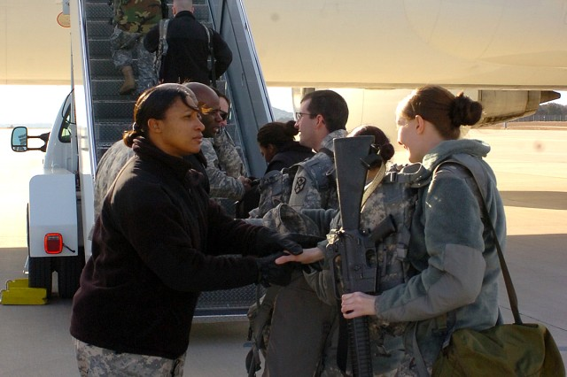 Soldiers from Detachment D, 230th Financial Management Company, say goodbye to members of their chain of command before boarding a plane bound for the Middle East Dec. 21 at Robert Gray Army Airfield. The Soldiers began a year-long deployment in support of Operation Iraqi Freedom.