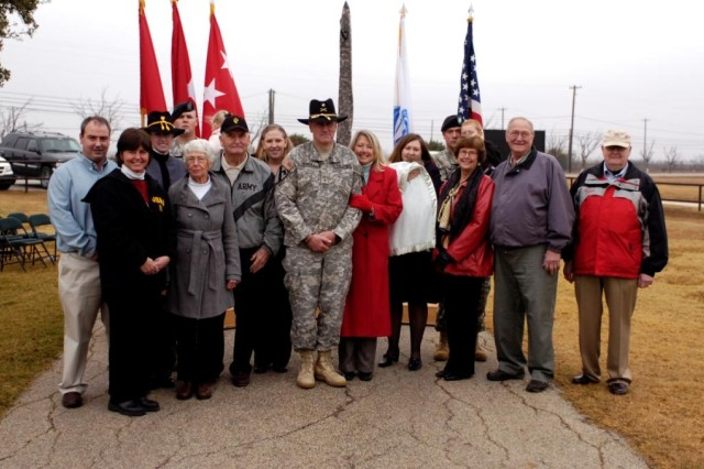 Members and friends of the Murray family stand proudly after the promotion of Brigadier General John (Mike) Murray, Dec. 23 at the 1st Cavalry Division Stables. From left to right:  Matt Murray (brother), Cindy Murray (sister), Cadet Jayna Murray (daughter), Sergeant  Chris Fox (son-in-law), Janet Murray (mother),  John Murray (father), Jessica Fox (daughter), Brigadier General Murray, Jane Murray (wife),  Jennie Furlow (daughter), Staff Sergeant Rick Furlow (son-in-law), Rosemary Fitzgerald (mother-in-law), Gary Fitzgerald (father-in-law), and Sergeant Major (R) Bob Smith.