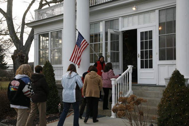 PICATINNY ARSENAL, N.J. - PMCC member Chan Caggins welcomes the tour into the Picatinny commanding general's home.