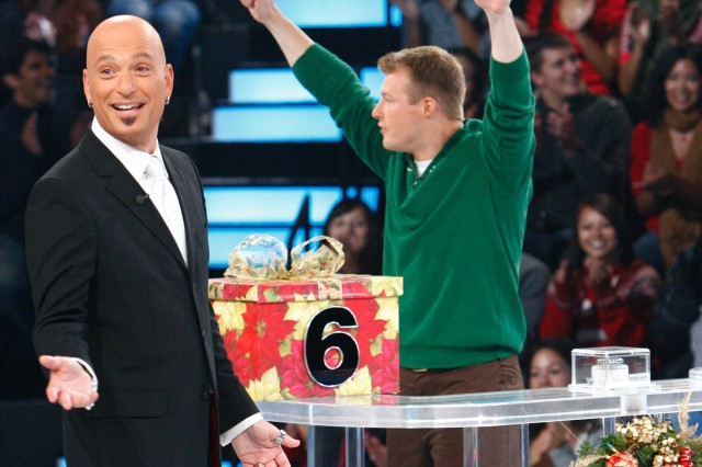 "SSG Matt Zedwick celebrates with game show host Howie Mandel as he competes in a special holiday airing of Aca,!A""Deal or No Deal.Aca,!A?"