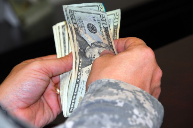 Soldiers can look forward to a 3.9 percent pay raise in 2009.  Under the new pay tables, a sergeant with five years of service would see an increase in monthly base salary of about $88 dollars. A captain with nine years of service would see nearly $200 a month extra. (Photo illustration)