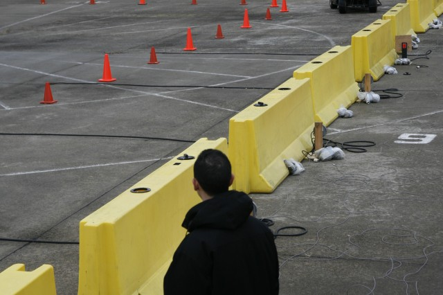 PICATINNY ARSENAL, N.J. - An enclosed golf-cart driver rounds a corner in an experiment hosted by ARDEC's Target Behavioral Response Laboratory staff.