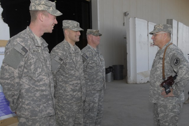 Lt. Gen. Jack Stultz, chief of the Army Reserve and commanding general of the Army Reserve Command, visits the Corps Distribution Center and speaks with Soldiers from the 259th Combat Sustainment Support Battalion,  who support the 3rd Sustainment Command (Expeditionary), to hear about the ordering and distribution process at Joint Base Balad Dec. 25.