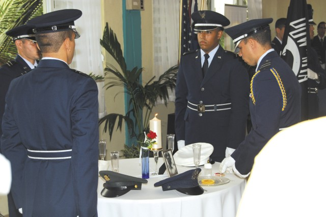 Cadets of the Air Force ROTC Detachment 755, University of Puerto Rico Rio Piedras Campus, performed a silent ceremony of respect for all fallen Servicemembers from America's conflicts. (Photos Marc McCormick)