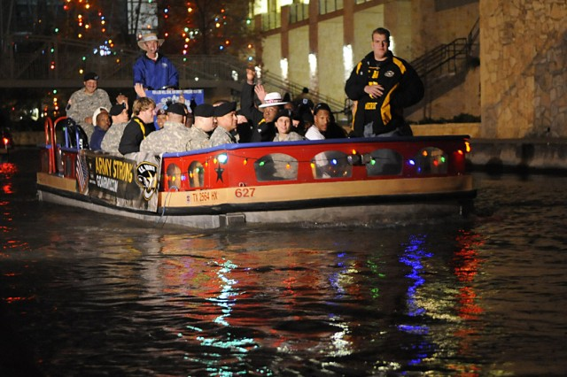 Soldier-Heroes and players cruise together on the San Antonio River through the famed River Walk in downtown San Antonio on New Year's eve.  Each of the 85 Soldier-Heroes were matched with a player during pre-game activities prior to the start of the All-American Bowl high school all-star football game at the Alamodome.