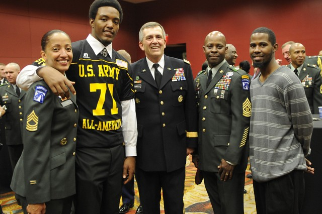 Soldier-Hero and Mom, Master Sgt. Fotini Nixon poses with son, and East all-star Xavier, along with Army Vice Chief of Staff Peter W. Chiarelli and dad, Command Sgt. Major Kenneth Nixon during a reception honoring the Soldier-Heroes.  All were involved in the U.S. Army-sponsored All-American Bowl in San Antonio, Texas.