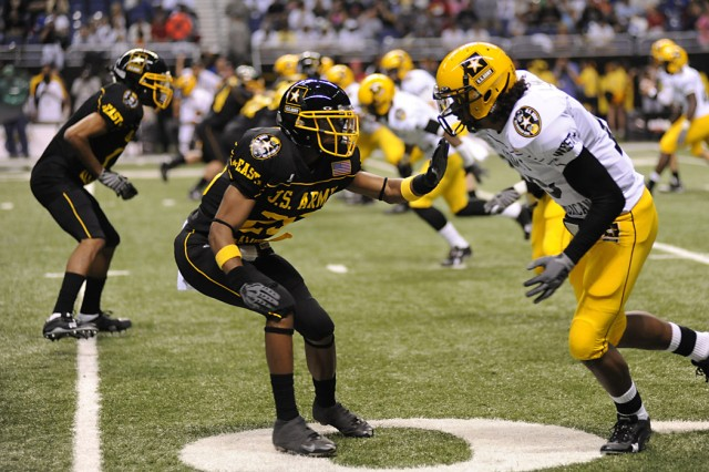 The West team (white jerseys) starts an offensive drive at the start of the U.S. Army-sponsored All-American Bowl football game pitting the top high school athletes in the nation. The East team won the contest 30 -- 17.