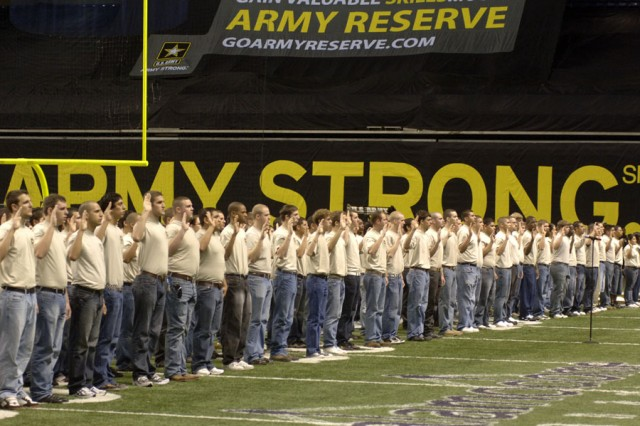 A group of delayed entry program enlistees recite the oath of enlistment from Army Vice Chief of Staff Gen. Peter W. Chiarelli during a pre-game ceremony in the Alamodome prior to the start of the All-American Bowl high school all-star football contest.