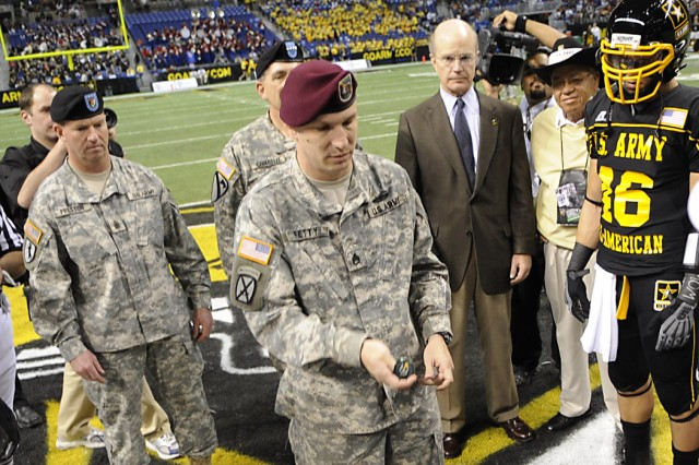 Staff Sgt. Jason T. Fetty flips the coin to start the 2009 All-American Bowl in the Alamodome in San Antonio, Texas.  Fetty is a civil affairs NCO at Fort Bragg, N.C., and was one of 85 Soldier-Heroes representing the Army during pre-game activities. Sergeant Major of the Army Kenneth O. Preston, Army Vice Chief of Staff  Gen. Peter W. Chiarelli, and Secretary of the Army Pete Geren assisted in the ceremonial toss.