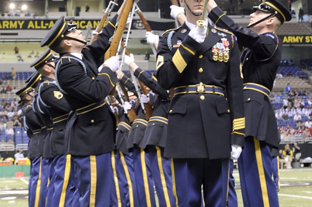 """The U.S. Army Drill Team uses bayonet-tipped 1903-style Springfield rifles during a demonstration of their skills during the pre-game activities before the start of the All-American Bowl high school football game in the Alamodome in San Antonio, Texas. The team is part of the 3rd U.S. Infantry """"Old Guard."""""""