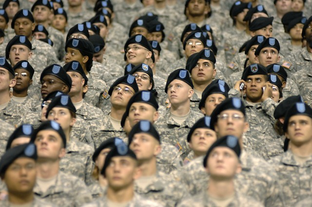 Soldiers attending medical advanced individual training at Fort Sam Houston, in San Antonio, Texas, line the stands during the 2009 All-American Bowl all-star football contest pitting the top high school players in the nation in an East versus West matchup.