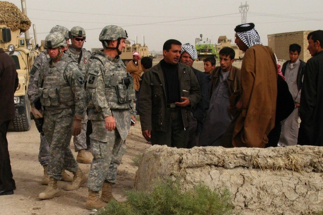 Shaykh Al Habeb and his followers welcome Lt. Col. Clint Moyer, Civil Affairs, 287th Sustainment Brigade, to the village of Al Habeb in Muthanna province, Iraq  on Dec. 23.