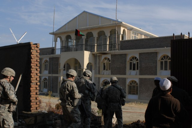 Soldiers of the 1st Infantry Division's Alpha Company, Special Troop Battalion, 3rd Brigade Combat Team, enter the Shirazad District Center in Afghanistan's Nangarhar province to meet with the sub-governor of the area.