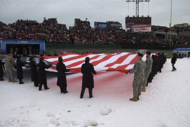 Chicagoland Soldiers and JROTC Cadets from the George S. Patton Military Academy unfurl the American Flag during the singing of the National Anthem at the 2009 NHL Winter Classic.  The Winter Classic was played in Chicago's Wrigley Field January, 1 2009.