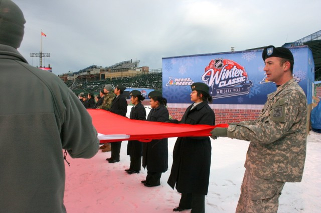Capt. John Kirchgessner, U.S. Army Chicago Recruiting Battalion, and JROTC Cadets from the George S. Patton Military Academy practice unfurling the American flag for the 2009 NHL Winter Classic.  The Winter Classic was played in Chicago's Wrigley Field on January 1, 2009.