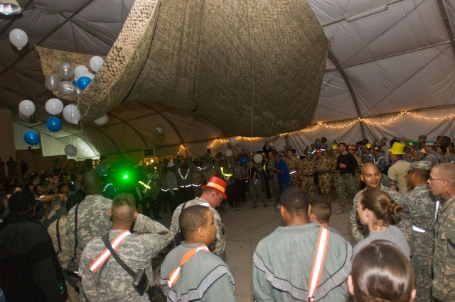 Soldiers assigned to the Long Knife Brigade and other supporting units at Contingency Operating Base Adder ring in 2009 with a balloon drop at the stroke of midnight. The New Year marked the passage of time for some Soldiers while it served as a memorable marker for where they were for others.