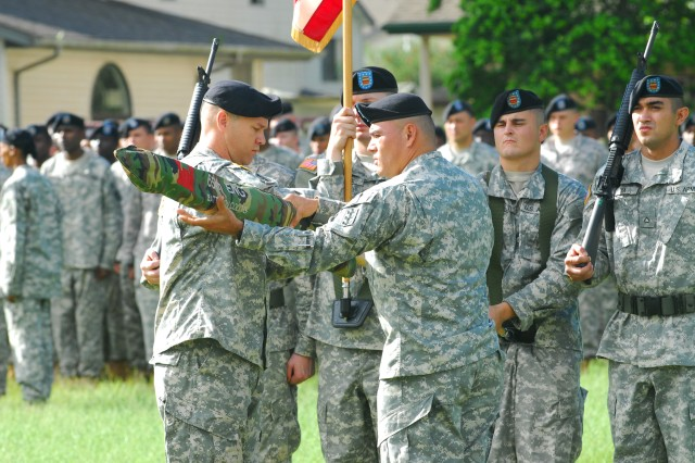 Lt. Col. Scott Petersen, Commander, 65th Engineer Battalion, and 1st Sgt. Juan Azucena case the battalion colors during a deployment ceremony on Hamilton Field, Schofield Barracks, Dec. 31. The 65th Eng. Bn. headquarters is deploying in support of Operation Iraqi Freedom for the first time.