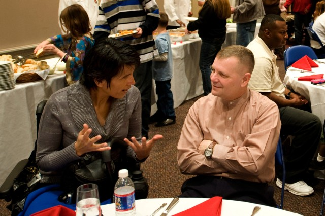 Staff Sgt. Liliana Caparo shares her observations of Walter Reed and the Veteran Affairs program with Vice Chairman of the Joint Chiefs of Staff Marine Gen. James Cartwright during a luncheon in Washington, D.C., Feb. 16, 2008.