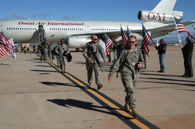 More than 130 Soldiers from the 11th Signal Brigade disembark from a plane Dec. 24, at Libby Army Airfield at Fort Huachuca, Ariz.  Thunderbird Soldiers returned from a 15-month tour in Iraq.