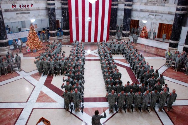 Lt. Col. Linda Jantzen (bottom center), 40th Signal Battalion commander, administers the Oath of Enlistment to more than 120 Soldiers of her unit at 12:01 a.m., Jan. 1, at Al Faw Palace in Baghdad, Iraq.  The event was part of a coordinated battalion mass reenlistment, with simultaneous reenlistments occurring in Bagram and Kandahar, Afghanistan, and Fort Huachuca, Ariz.