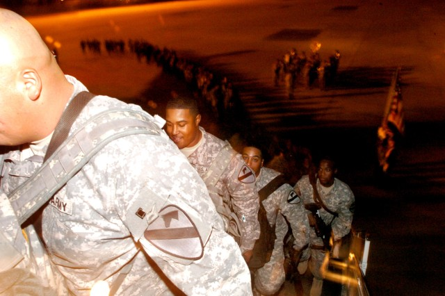 2nd Brigade Combat Team, 1st Cavalry Division, Soldiers head into the plane bound for Iraq as the 1st Cavalry Division Honor Guard and Band sends them off in cavalry fashion at Gray Army Airfield Jan. 3.