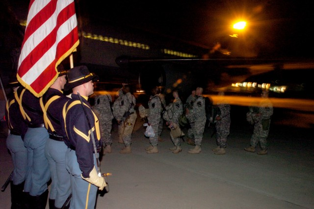 The 1st Cavalry Division Honor Guard and Band were on hand to send Soldiers from 2nd Brigade Combat Team, 1st Cavalry Division, off to Iraq in true cavalry fashion at Gray Army Airfield, Texas Jan. 3.