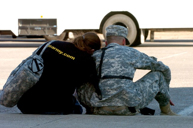 2nd Brigade Combat Team, 1st Cavalry Division, Soldiers had a chance to spend a few moments with their loved ones outside Howze Theater on Fort Hood, Texas before heading off to Gray Army Airfield Jan. 3