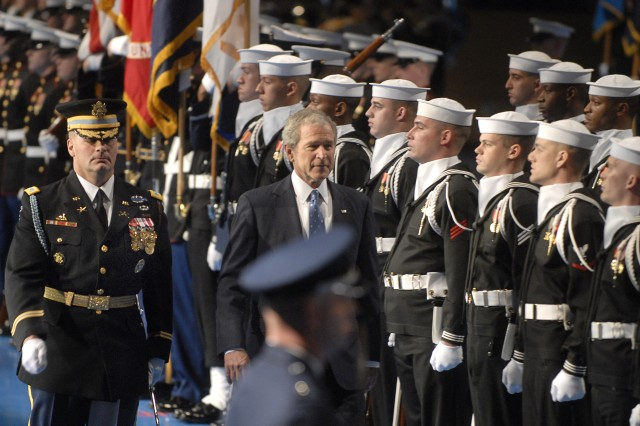 President George W. Bush inspects the troops at the Armed Forces Farewell Tribute at Conmy Hall on Fort Myer, Va., Jan. 6, 2009. Defense Secretary Robert Gates and Navy Adm. Mike Mullen, chairman of the Joint Chiefs of Staff, also attended the event.