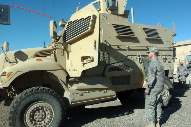 Pfc. Joshua Hunter from the 10th Mtn. Div. who serves as a quick reaction force gunner communicates with the MRAP driver during training conducted at Camp Victory Jan. 1.