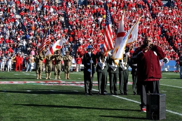 American Idol's second-season winner Ruben Studdard sings the National Anthem during the pre-game military appreciation show at the 2008 Papajohns.com Bowl in Birmingham, Ala. The salute was led by the U.S. Army 81st Regional Support Command's color guard wearing vintage WWII uniforms (background). They were joined by the University of Alabama's Reserve Officer Training Corps color guard (center) in a salute to former and current members of the military.
